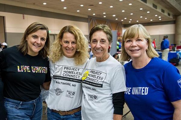Laura Bush, left, and fellow Women United member volunteers